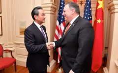Secretary Pompeo Shakes Hands With Chinese State Councilor and Foreign Minister Wang.  Free Use Image Courtesy of Flickr.com
