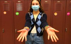 Margot Schneider '22, with wrists covered in Sillybandz and Rainbow Loom bracelets. Both jewelry items were popular during the time when Margot was in lower school.