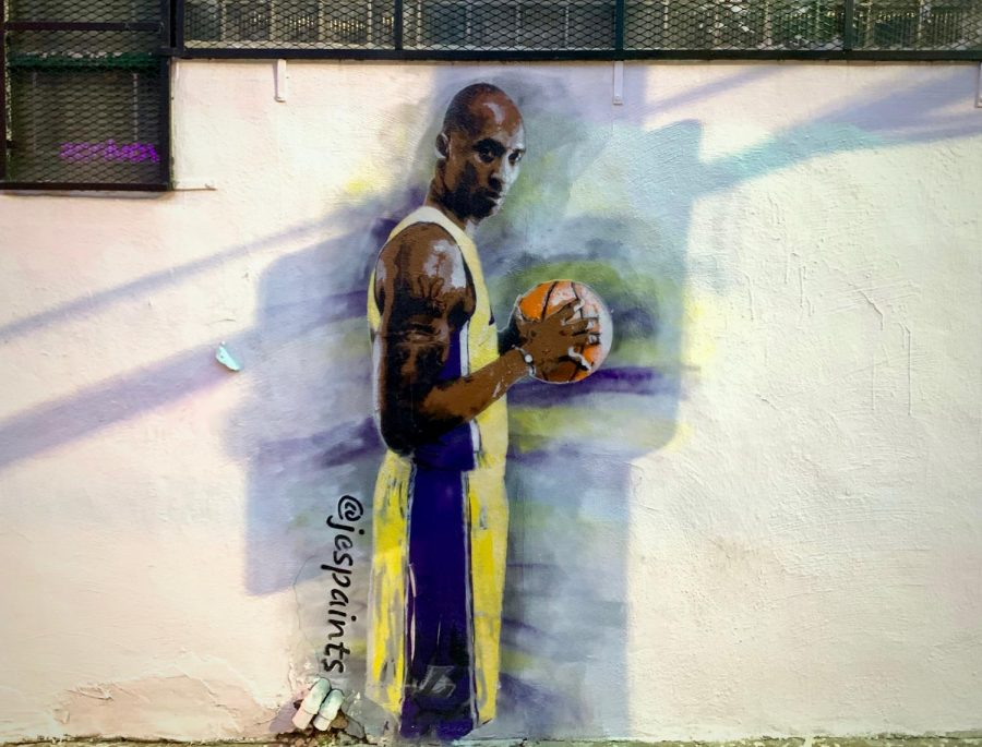 The late Kobe Bryant painted on a white wall in Lakers jersey. Found on 2nd St.