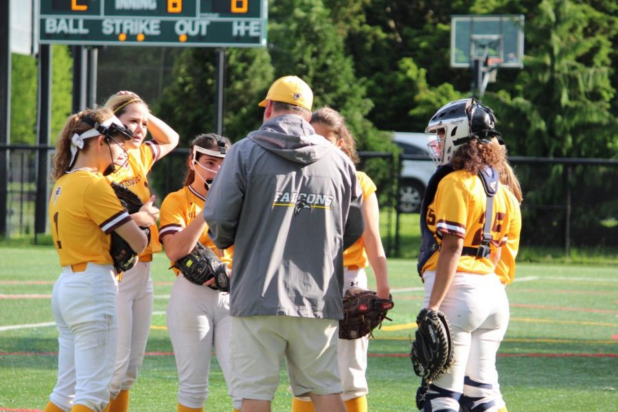 Bill in a huddle with FSS softball players.
